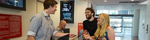 Image of happy customers collecting tickets from Canberra Theatre Box Ofice